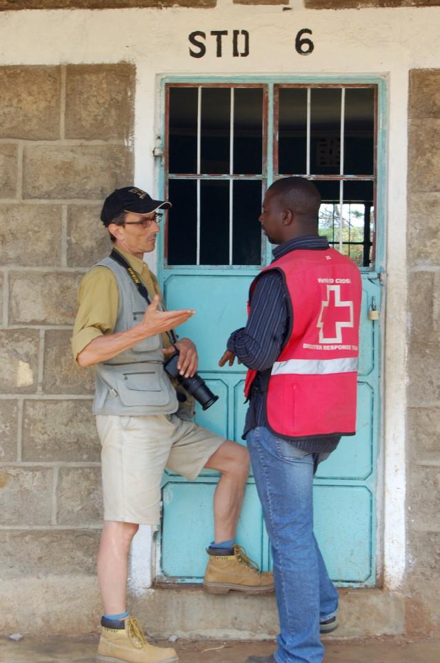 Swiss Photojournalist Gerd Müller with a Red Cross Kenya Eldoret Mission Deputy visitng the refugie camps and rebuilt schools
