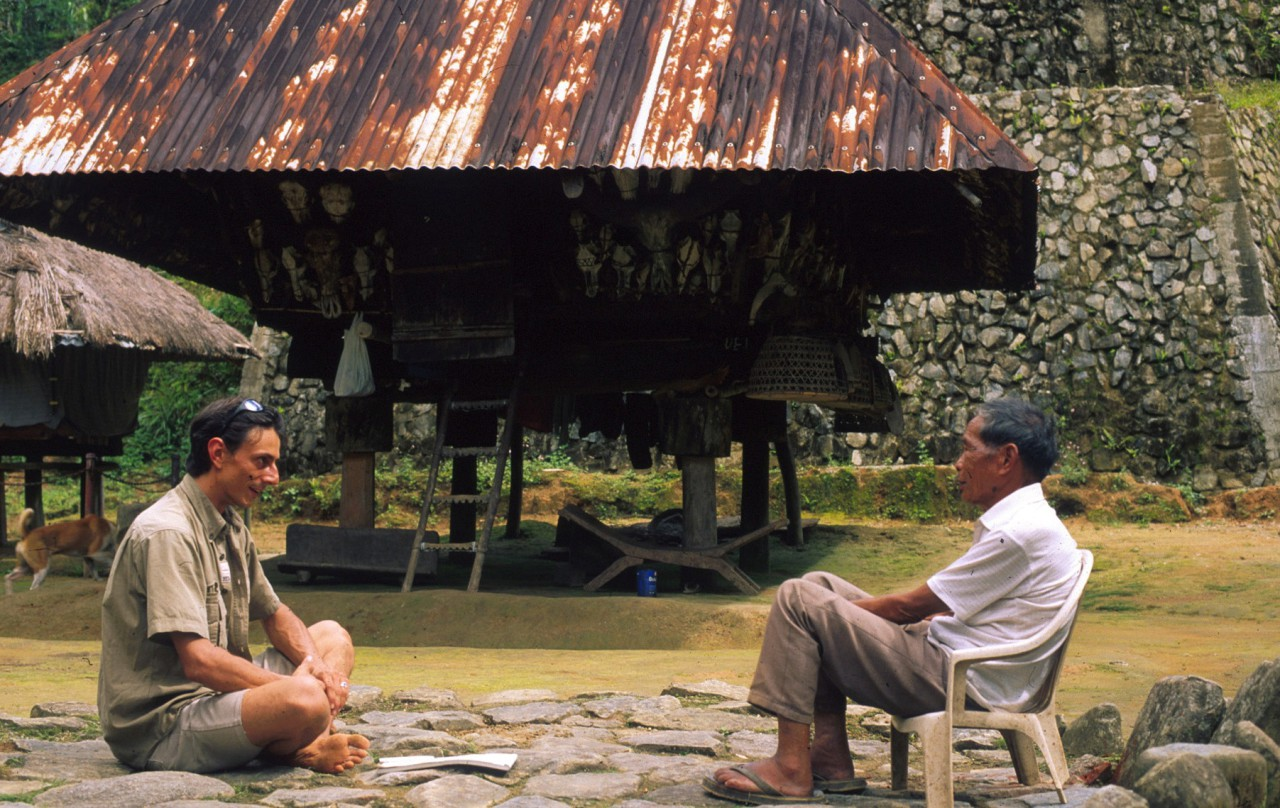 Swiss Photojournalist Gerd Müller talking to the local chief of the tribal people in the Philippines